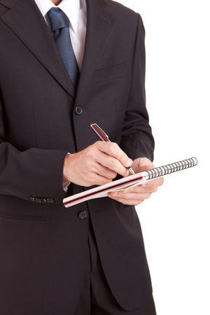 Business man signing document, isolated over white photo