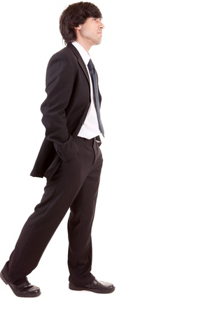 Young business man walking, isolated over white photo