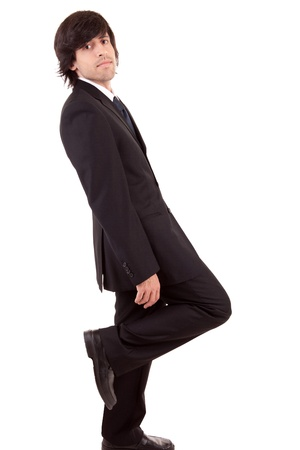 Business man leaning against wall, isolated over white Stock Photo - 11963628