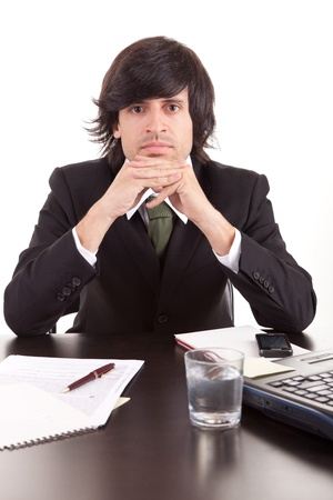 Young business man at work, isolated over white photo