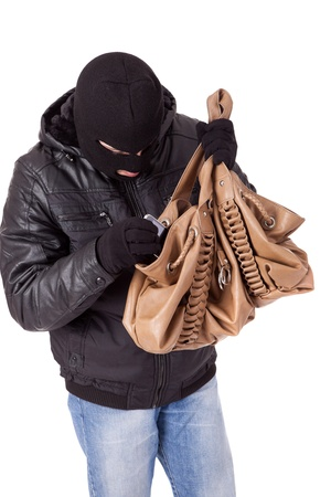 Thief, stealing a purse, isolated over white photo