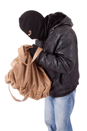 perpetrator: Thief, stealing a purse, isolated over white Stock Photo