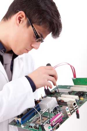 Computer engineer working on a old motherboard Stock Photo - 12958345