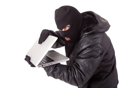 Computer hacker with white laptop Stock Photo - 12958339
