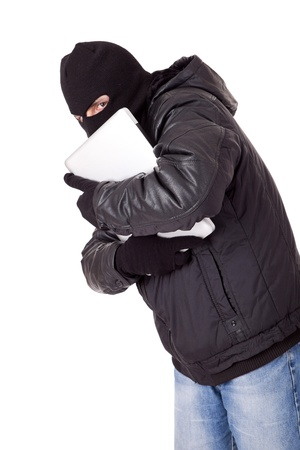 Thief holding a white laptop photo