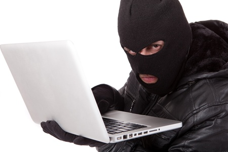 Disguised computer hacker Stock Photo