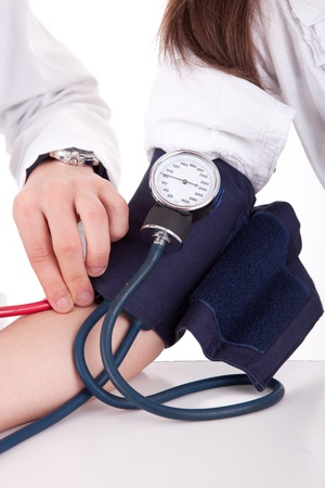 taking pulse: Blood pressure measuring. Doctor and patient. Health care.  Stock Photo
