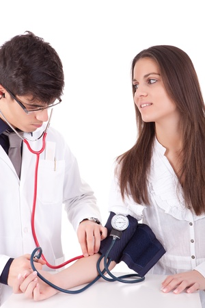 Blood pressure measuring. Doctor and patient. Health care.  photo