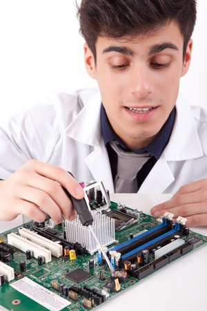 Computer engineer working on an old motherboard Stock Photo - 13209879