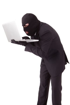 Disguised computer hacker Stock Photo - 13211019