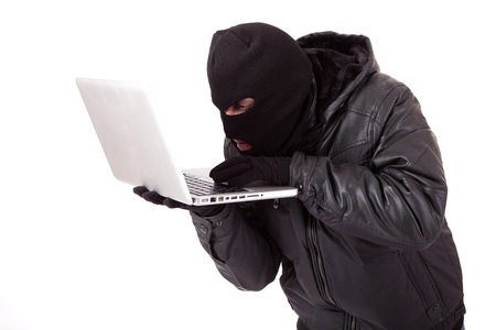 Disguised computer hacker photo
