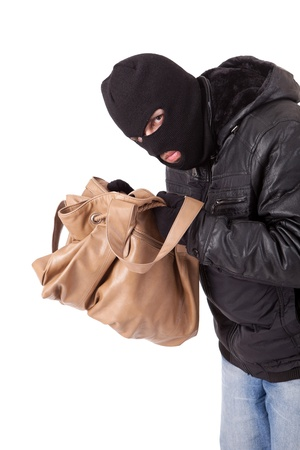 A Thief, stealing a purse photo