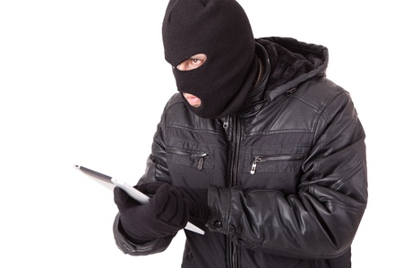 Disguised computer hacker Stock Photo - 13209977