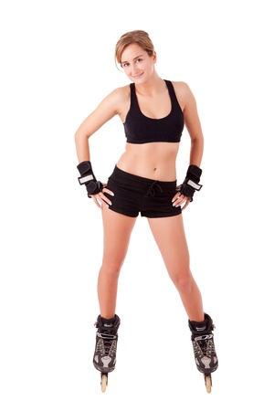 roller blade: Young woman in rollerskates - fitness concept Stock Photo