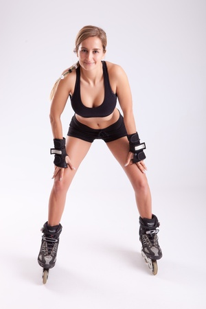Young woman in rollerskates - fitness concept photo