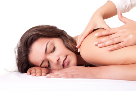 Beautiful young woman receiving a massage Stock Photo