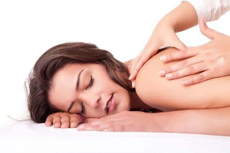 Beautiful young woman receiving a massage Stock Photo