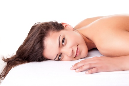 woman in towel: Beautiful young woman receiving a massage Stock Photo