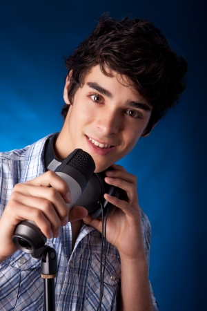 hansome: Young and very hansome boy singing, on blue background