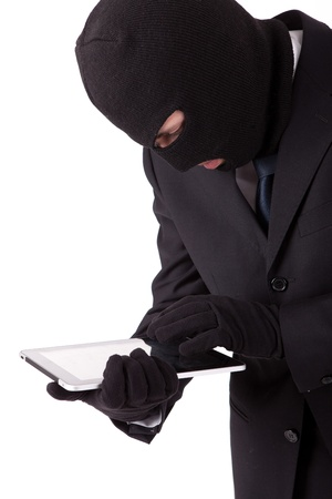 A Disguised computer hacker in suit and tie photo