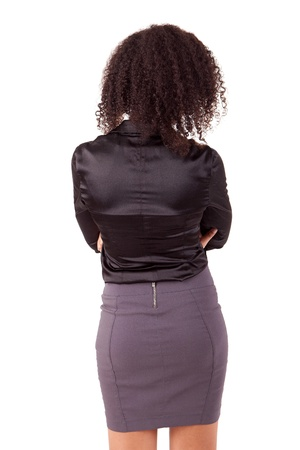 Business woman posing backwards isolated over white photo