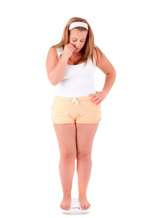 gluttonous: Large woman on a scale - diet concept Stock Photo
