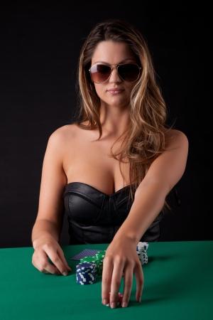 gamble: Very beautiful woman playing texas holdem poker