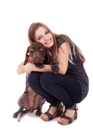 Beautiful woman and young dog - isolated over white Stock Photo - 14325853