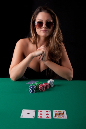 Very beautiful woman playing texas holdem poker
