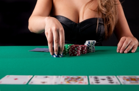 gambler: Very beautiful woman playing texas holdem poker