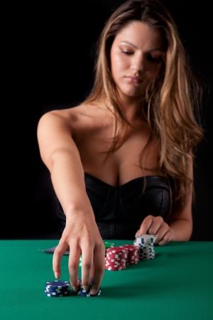 Very beautiful woman playing texas holdem poker photo