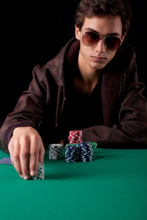 Young handsome man playing texas hold'em poker photo