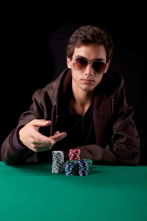 Young handsome man playing texas holdem poker