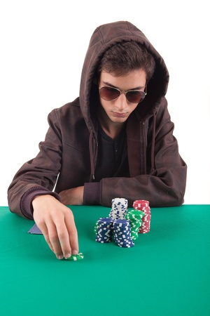 Young handsome man playing texas holdem poker photo