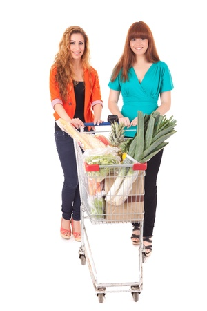 Beautiful young women shopping at the supermarket photo