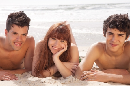 sexy couple on beach: Happy group of friends at the beach Stock Photo