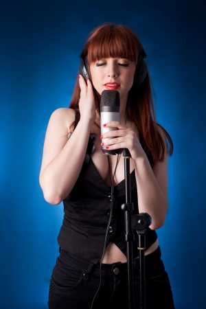 A young and very beautiful woman singing photo
