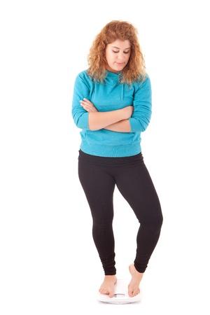 diet concept: Large woman on a scale - diet concept Stock Photo