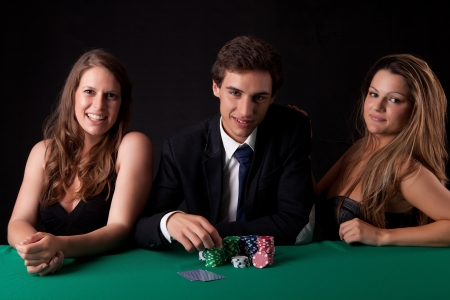 texas holdem: Young handsome man playing texas holdem poker
