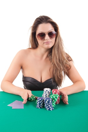 Very beautiful woman playing texas holdem poker photo