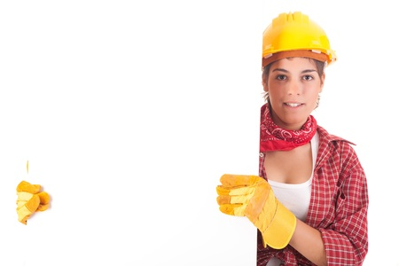 Sexy young woman construction worker, holding a white board