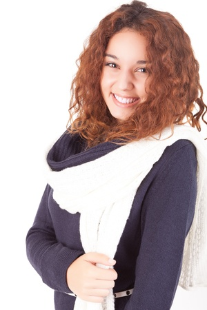 A beautiful young woman dressed for winter, over a white background