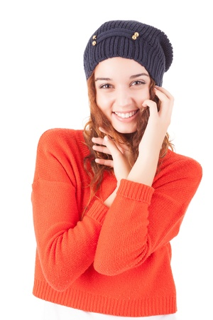 A beautiful young woman dressed for winter, over a white background photo