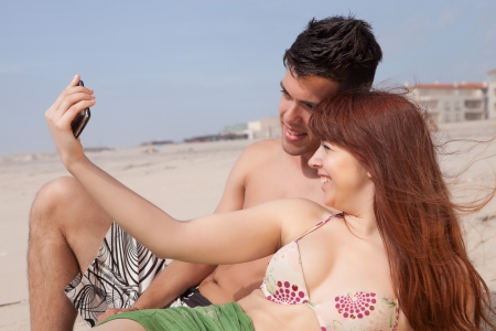 Young couple in love, relaxing at the beach photo