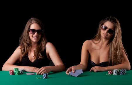Very beautiful women playing texas holdem poker photo