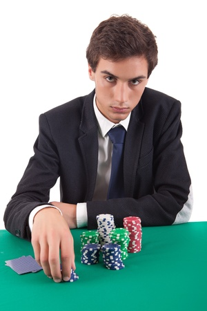 hold'em: Young handsome man playing texas holdem poker