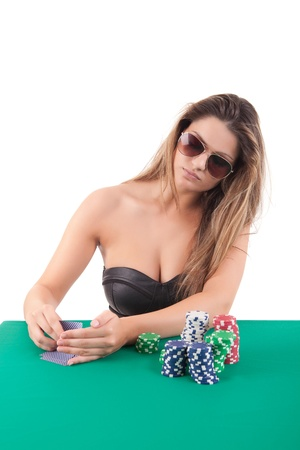 Very beautiful woman playing texas hold'em poker photo