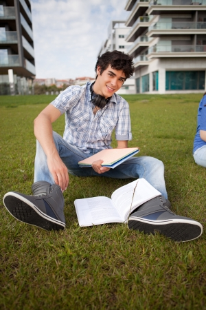 Young boy studying at the park photo