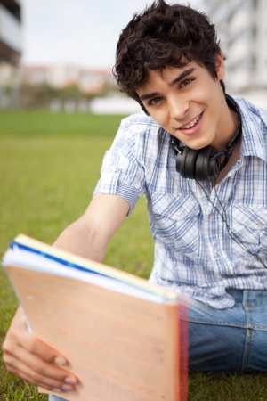 Young boy studying at the park Stock Photo - 14924737