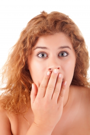 A young, beautiful and very surprised woman photo